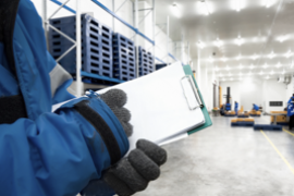 stock photo hand of worker with clipboard checking ready meals goods in the warehouse import and export